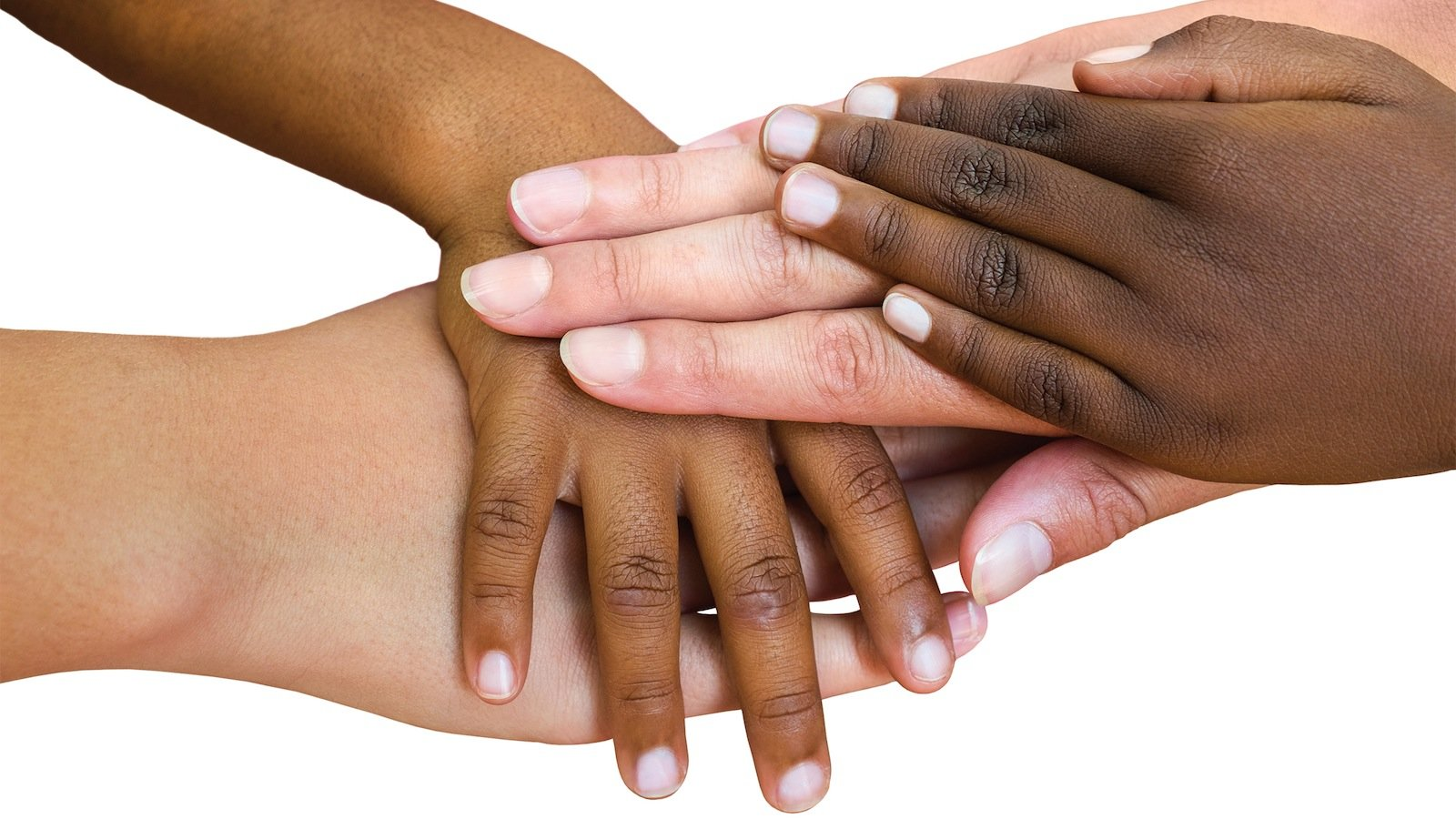 Macro close up of multiracial child hands joined together. Isolated on white background.